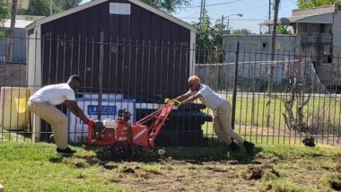 Two Civic Engagement AmeriCorps Members use sod cutter.