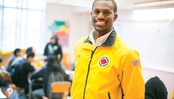 City Year AmeriCorps member yellow jacket student success coach