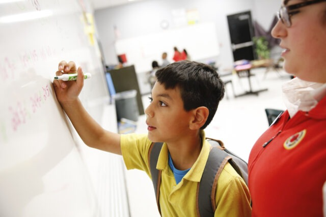 City Year AmeriCorps member promoting student success through social emotional learning