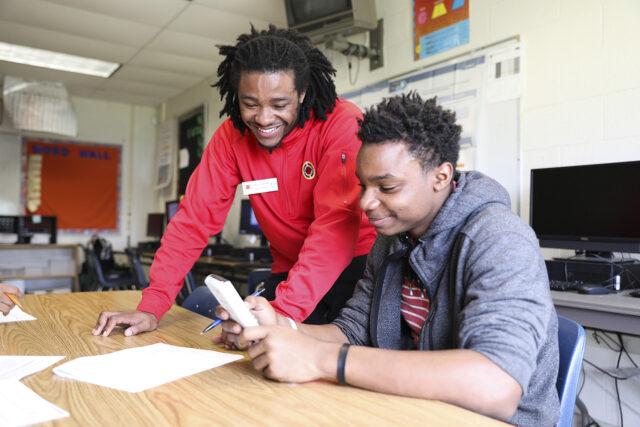 City Year AmeriCorps member tutors student