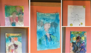 Several pieces of artwork created by students at ARISE Academy in art club with a City Year AmeriCorps member