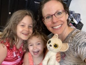 Kathleen smiles with two of her children.