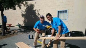 Carlos and fellow Alum Jackson Young volunteer at a Care Force event in East Palo Alto
