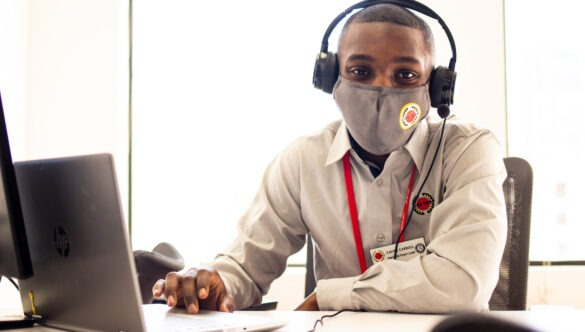 City Year AmeriCorps in school service with mask