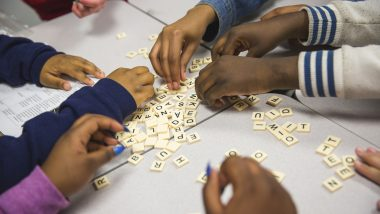 City Year member and students playing word games