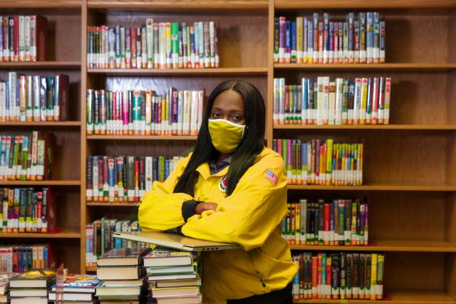 City Year AmeriCorps member serving in school with mask on