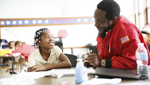 City Year AmeriCorps member with students in school