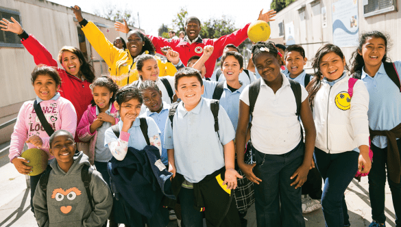 City Year AmeriCorps members with students at school