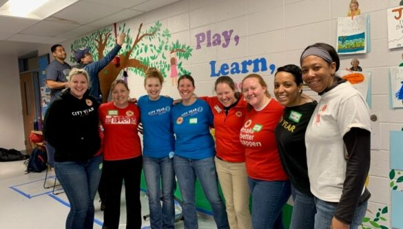 City Year AmeriCorps members and alumni in school