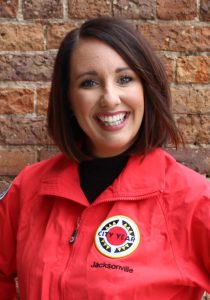 Allishia Bauman smiles as she wears her red City Year jacket