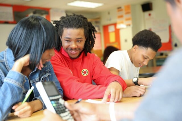 City Year AmeriCorps member student success coach with students