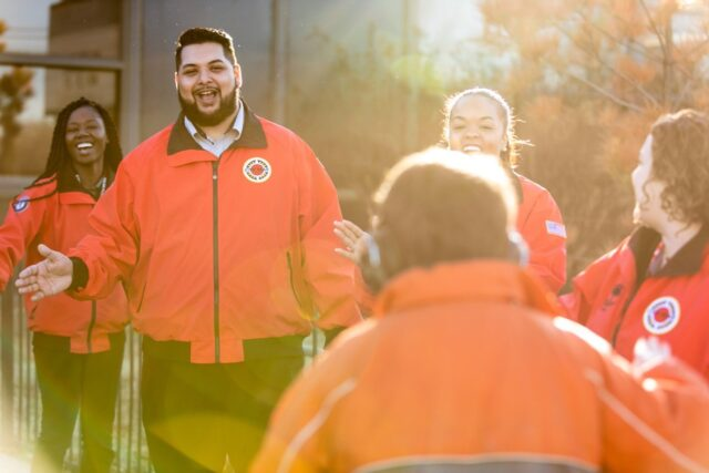 City Year AmeriCorps student success coaches morning greeting