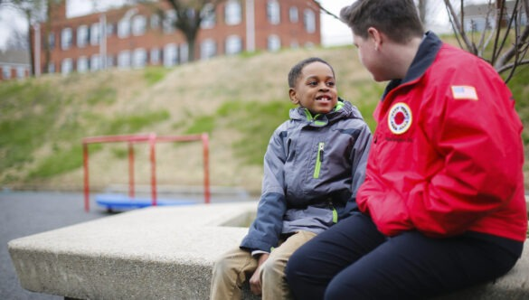 City Year AmeriCorps student success coach with student